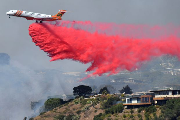 Crews work to contain pair of wildfires threatening homes in southern California