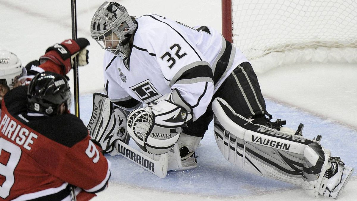 Los Angeles Kings goalie Jonathan Quick (R) makes a save on New Jersey Devils' Zach Parise (9) as Kings' Slava Voynov defends during the second period in Game 1 of the Stanley Cup final in Newark, New Jersey, May 30, 2012.