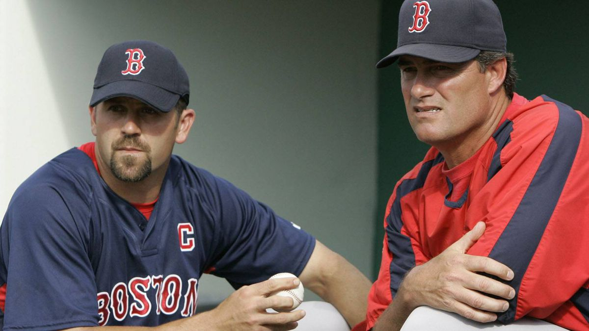 Boston Red Sox catcher Jason Varitek, left, talks with pitching coach John Farrell as they watch the field prior to a spring training baseball game against the Minnesota Twins in Fort Myers, Fla., Wednesday, March 28, 2007. (AP Photo/Charles Krupa)
