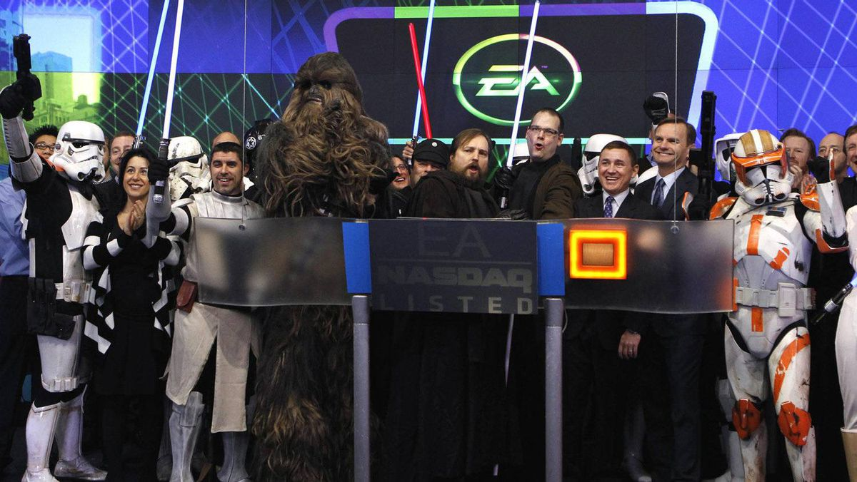 """Electronic Arts Inc. executives stand with Star Wars characters to ring the opening bell at the NASDAQ Market Site in New York, December 20, 2011. EA was celebrating Tuesday's launch of EA's """"Star Wars: The Old Republic"""" game and the re-listing of Electronic Arts Inc. on the NASDAQ under the new symbol """"EA"""". Pictured are (2nd R-L) NASDAQ Executive Vice President of the Corporate Client Group Bruce Aust, President of EA Labels Frank Gibeau, EA Senior Vice President Ray Muzyka and EA Vice President Greg Zeschuk."""