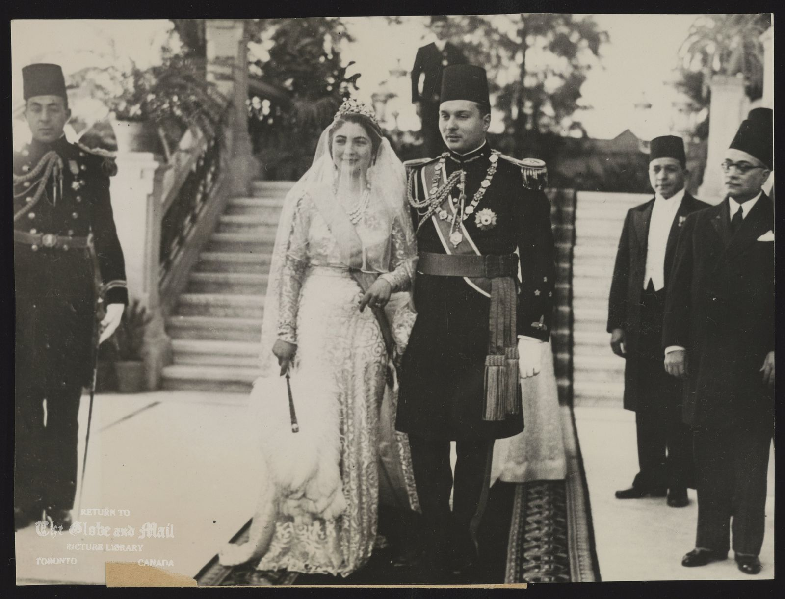 ASSOCIATED PRESS PHOTO - FROM LONDON. EGYPT WEDDING DAY PICTURE CAIRO EGYPT JANUARY 20: YOUTHFUL KING FAROUK OF EGYPT AND BEAUTIFUL 17 YEARS OLD MLLE. FARIDA ZULFICAR WERE MARRIED HERE TODAY AND IN ACCORDANCE WITH MOSLEM CUSTOM THE CEREMONY WAS NOT ATTENDED BY THE BRIDE WHO WAS SEATED IN A ROOM NEAR THE KING'S STUDY IN THE ROYAL PALACE HERE IN WHICH THE FORMALITIES WERE COMPLETED. ASSOCIATED PRESS PHOTO SHOWS: KING FAROUK AND QUEEN FARIDA PHOTOGRAPHED ON THE DAY OF THEIR MARRIAGE. BEGY 177874 25138 P. ALL-EX-B.F.D.P.