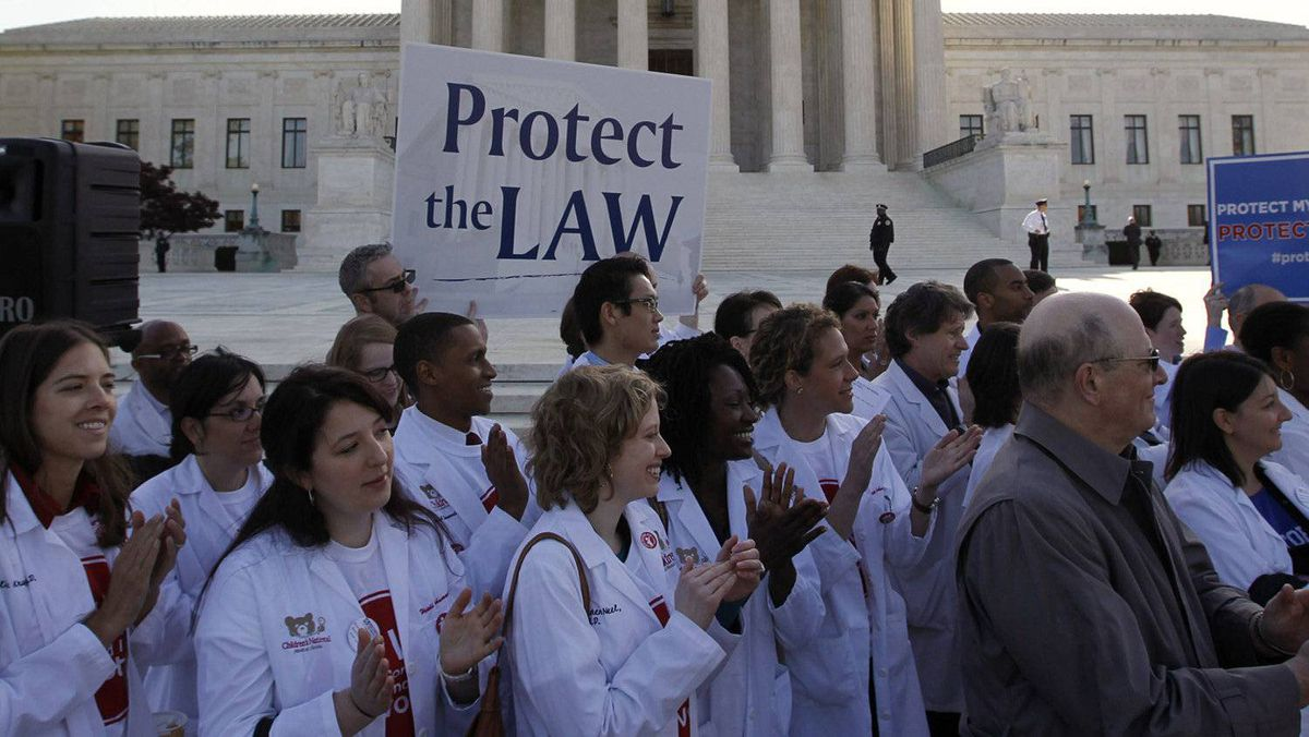 Medical students show their support for U.S. President Barack Obama's healthcare law during the first day of legal arguments over the Affordable Care Act at the Supreme Court in Washington March 26, 2012.