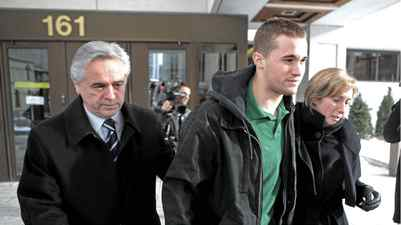 Former Premier of Newfoundland Brian Tobin, (left) and wife Jodean Tobin (right) escort their son Jack Tobin (centre) out of Ottawa court following his release on bond for $100,000 for being charged in the death of a man in a Christmas Eve accident in Ottawa on Saturday, December 25, 2010.