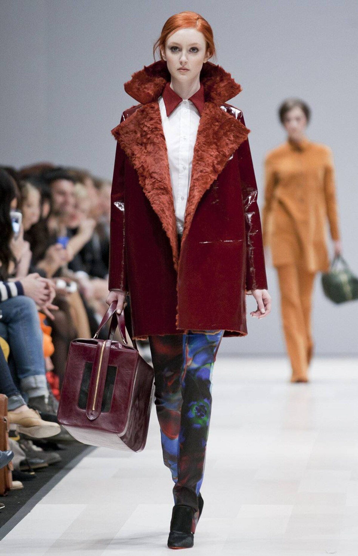 Accessories included big, woolly tuques in bright hues, furry details such as stoles and structured purses both big and small (with one burgundy bag so large it could double as a cat carrier).