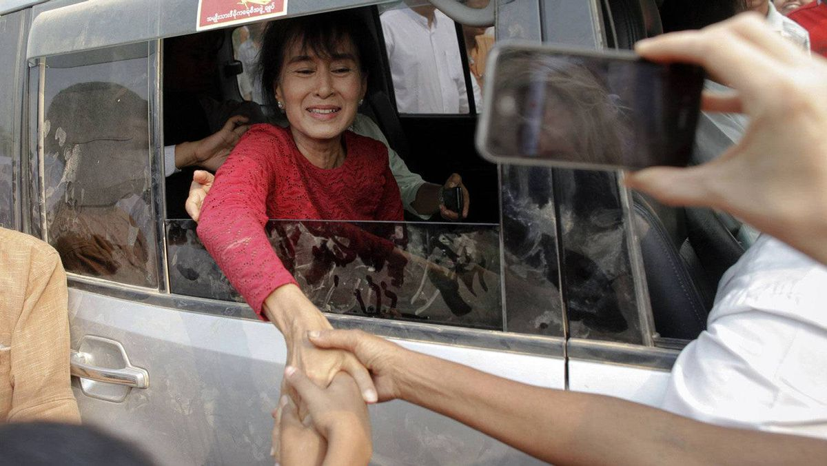 Aung San Suu Kyi is greeted outside a polling station in Kawhmu township April 1, 2012, where she stands as a candidate in parliamentary by-elections.