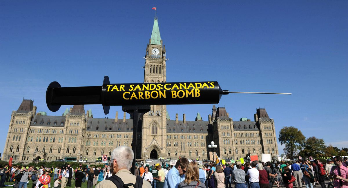 The Council of Canadians and Greenpeace Canada hold a rally featuring a civil disobedience sit-in against the tar sands on Parliament Hill in Ottawa on Monday, September 26, 2011.