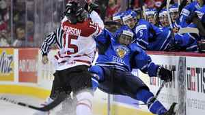 Canada's Tanner Pearson battles Finland's Ville Pokka in the first period of their bronze-medal game.