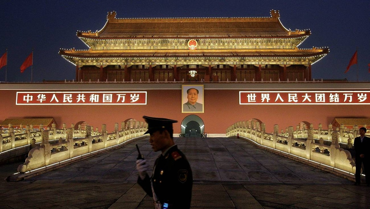 A Chinese paramilitary police officer stands guard in front of Tiananmen gate in Beijing on Sept. 29, 2009.