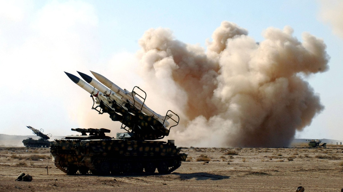 A handout picture released by the official Syrian Arab News Agency on Dec. 20, 2011, shows smoke billowing behind a missile launcher during military manoeuvres by the Syrian army in an undisclosed location in Syria.