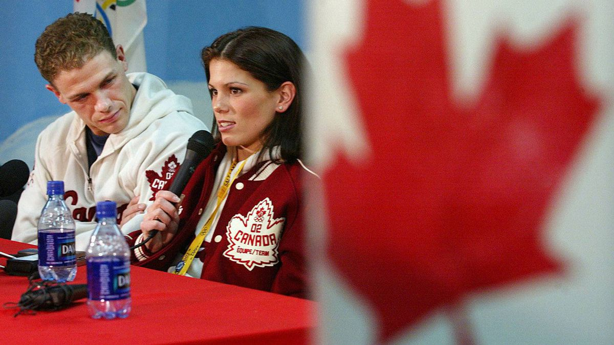 Olympic pairs silver medallist David Pelletier listens to his partner Jamie Salé respond to a question during a news conference at the XIX Olympic Winter Games in Salt Lake City, Utah, Tuesday Feb. 12, 2002. Sale and Pelletier won the silver medal Monday night after controversial judging of the Olympic pairs event.
