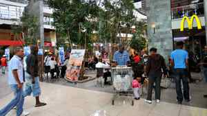 Soweto residents shop at Maponya Mall in Johannesburg, South Africa on March 19, 2010. This is the new Soweto, a mix of upper-crust comforts and urban grit, where shopping malls and landscaped parks have sprung up among some of South Africa's most important landmarks of the struggle against white-minority rule.