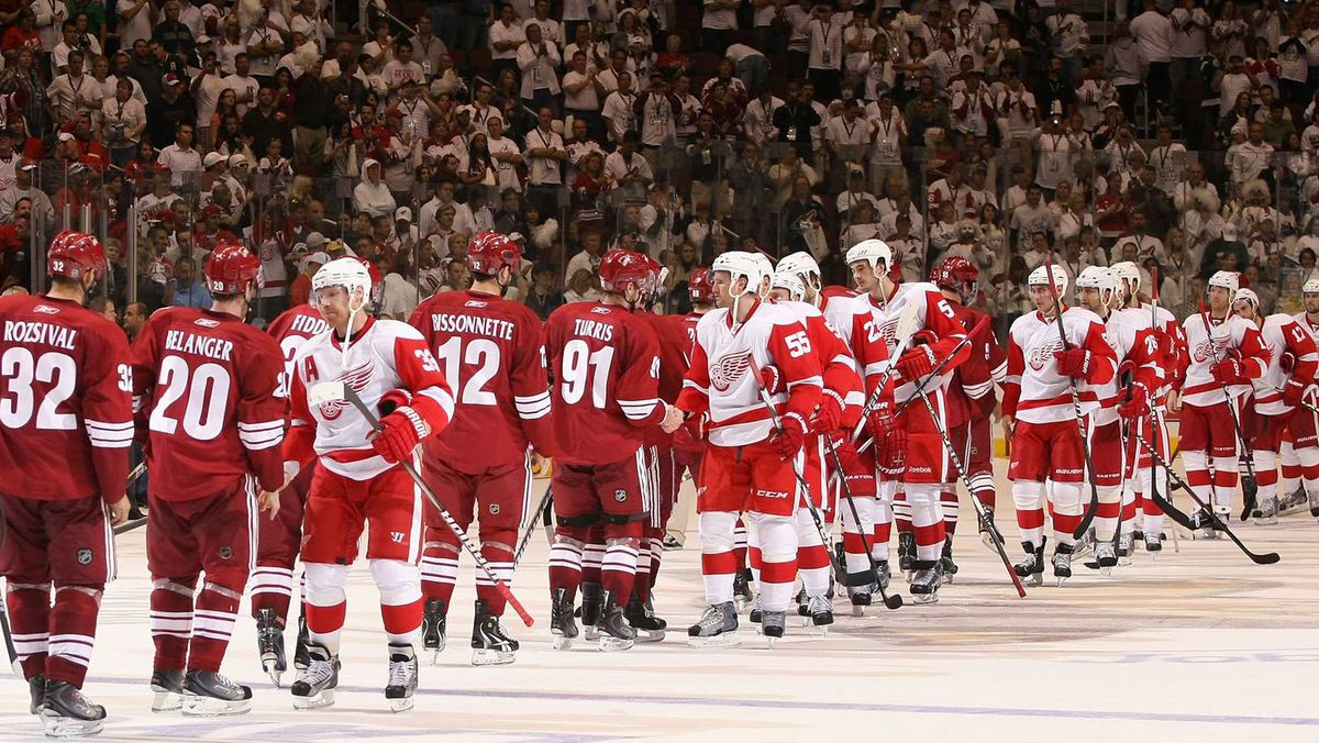 The Detroit Red Wings and Phoenix Coyotes shake hands following Game 4.