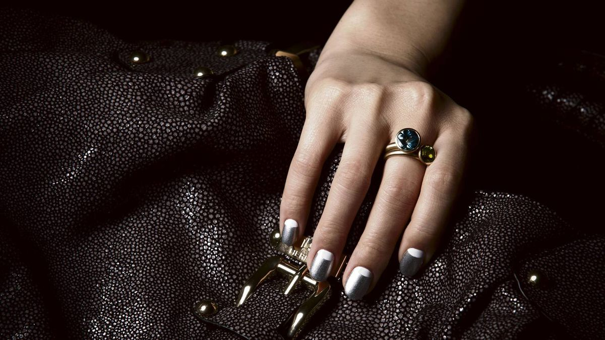 DECO DIVA: First seen in the 1930s, the half-moon mani is back – with a twist. Silver Revlon nail polish in Metallic, $7.99 at drugstores across Canada. White Essie nail polish in Blanc, $9.99. Anne Sportun Experimental Jewellery rings, $935 each through www.annesportun.com. Halston Heritage handbag, $495 at the Bay (www.hbc.com).