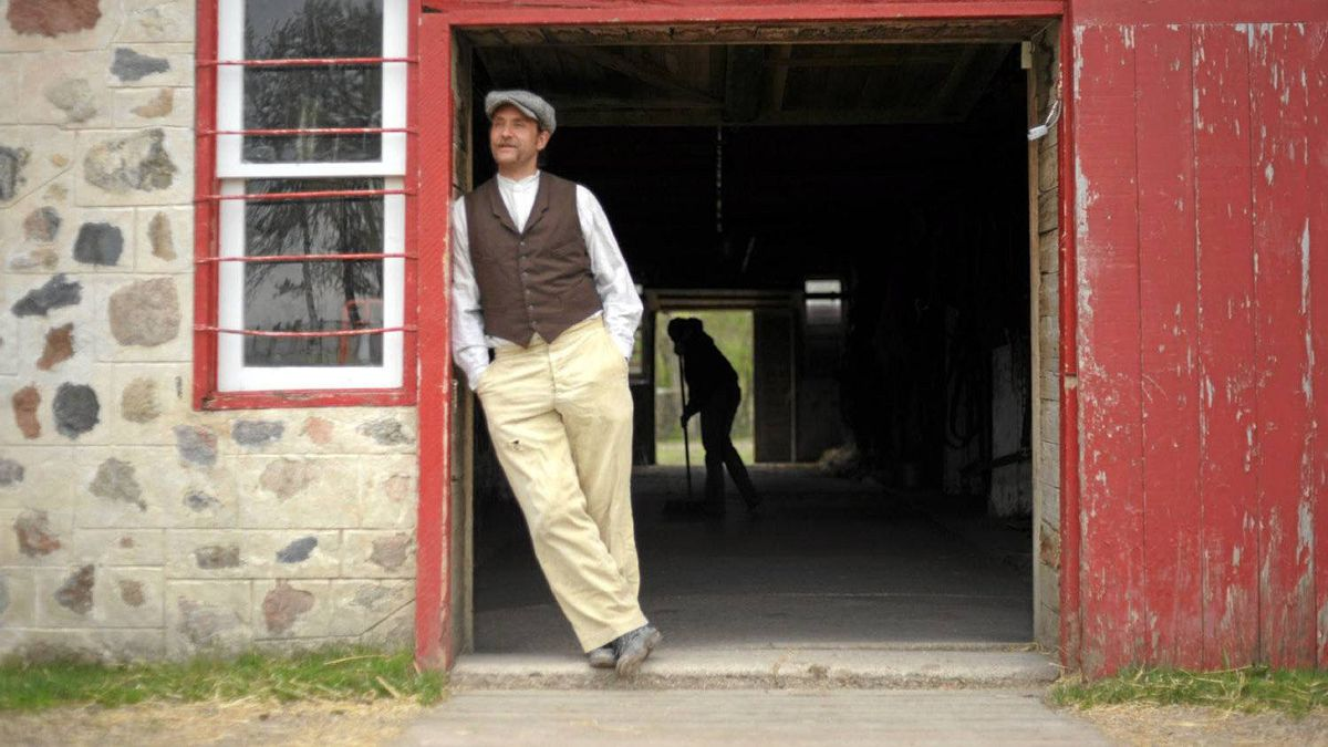 Sheldon Matsalla in the doorway of the 105-year-old barn at the Motherwell Homestead.