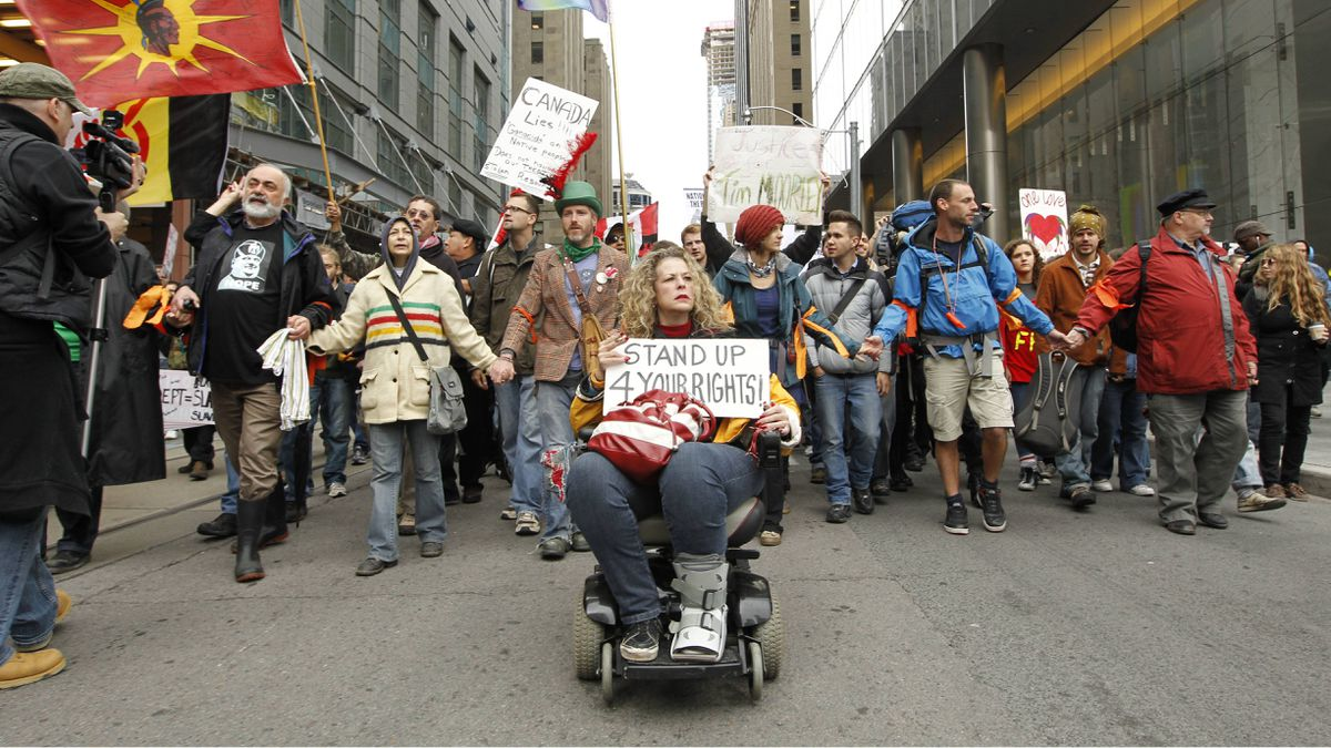 Protesters march in the streets of downtown Toronto during the Occupy protests on October 15, 2011.