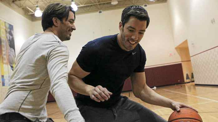 Jonathan, left, and Drew Scott, hosts of Property Brothers, play basketball at LA Fitness gym in Toronto on June 27, 2011.
