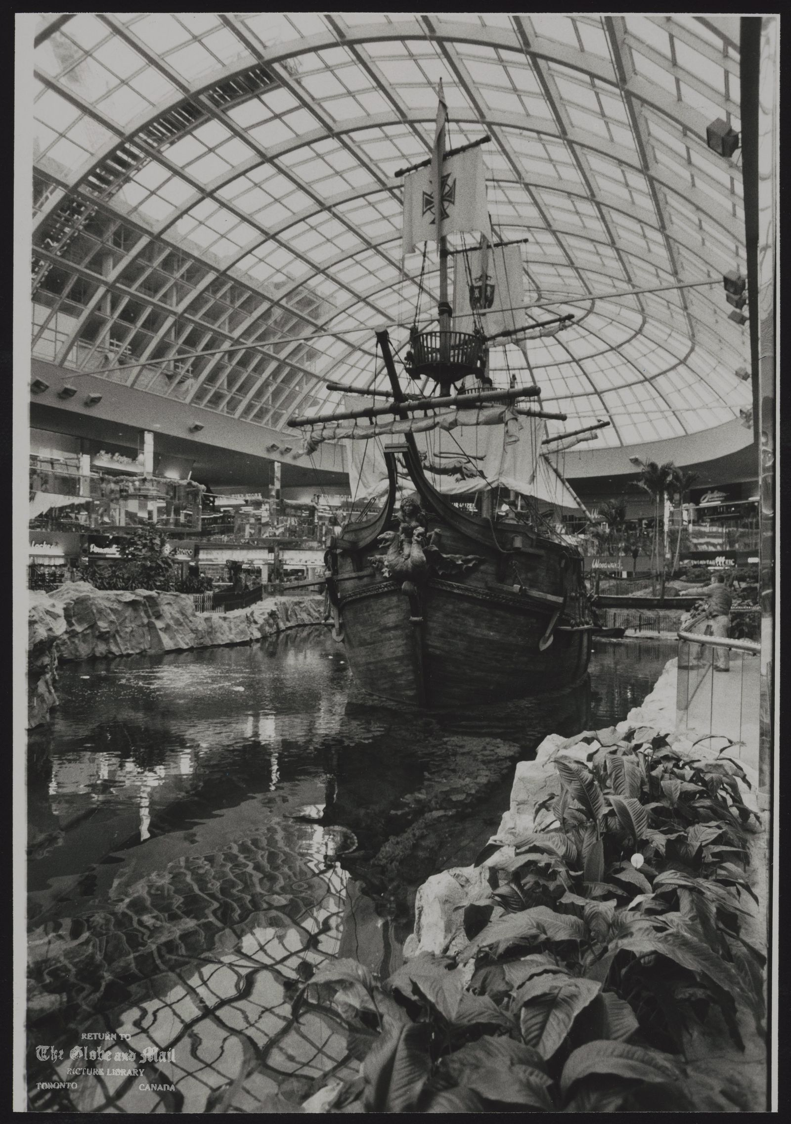 The notes transcribed from the back of this photograph are as follows: EDMONTON MALL, WEST