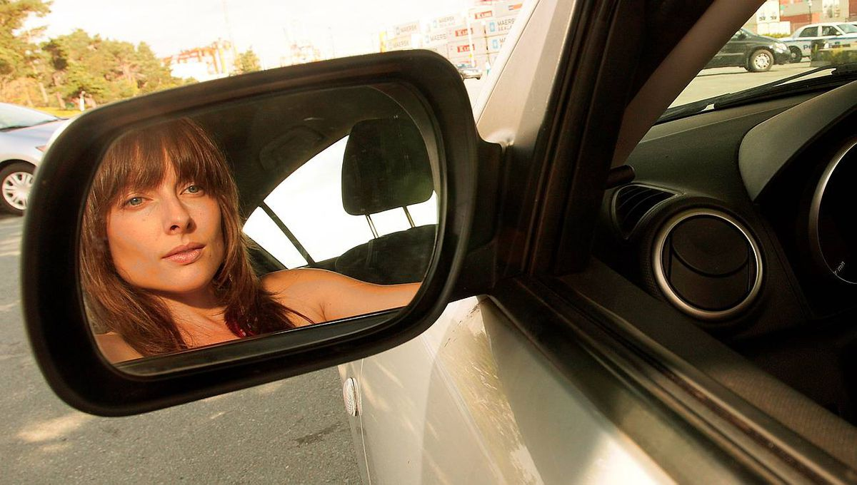 Singer Christana Martin is reflected in the mirror in Halifax, NS