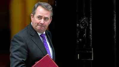 British Defence Secretary, Liam Fox, leaves after attending a cabinet meeting at 10 Downing Street on October 18, 2010.
