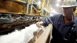 Rocanville Potash Corp mill production supervisor Dave Carter samples some potash on its process of being refined at the mill in Saskatchewan.