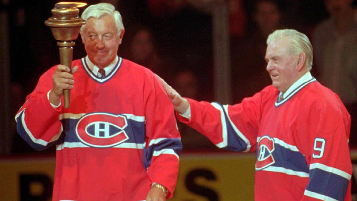 Montreal Canadiens greats Jean Béliveau, left, and Maurice (Rocket) Richard exchange a torch during closing ceremonies after the final game at the Montreal Forum, Monday, March 11, 1996.