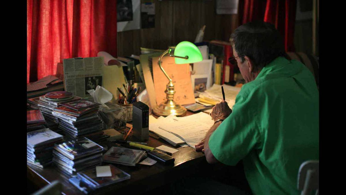This is the desk in the little stone house where Ian goes each morning to work at his songs. Voice recorder, memories, notes and a guitar close at hand.