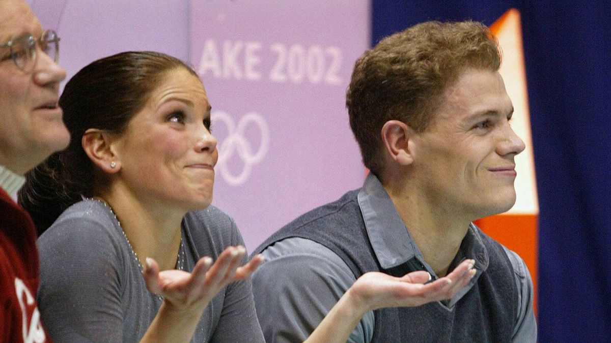 Jamie Salé and David Pelletier react as their marks are posted for their pairs free skate at the XIX Olympic Winter Games in Salt Lake City, Utah, Monday, Feb. 11, 2002. To the left is their coach Jan Ullmark (CP PHOTO/Paul Chiasson)