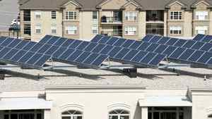 Solar panels on a rooftop. Solar power companies are feeling the pinch from overcapacity, intense competition and doubts about government subsidies.
