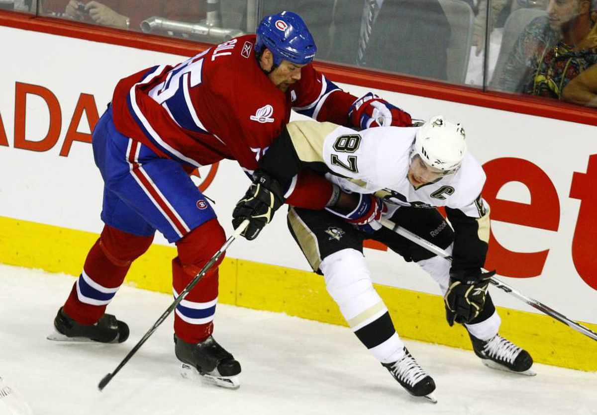Montreal Canadiens' defenceman Hal Gill holds on to Pittsburgh Penguins Sidney Crosby during second period of Game 3 NHL Eastern Conference semi-finals hockey action Tuesday, May 4, 2010 in Montreal.