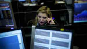 Cristina Povoa, a Portuguese broker, works the phones on Monday, Jan. 10, as the country's sovereign debt crisis worsended.