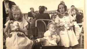 Jean Miller, then eight years old, celebrated the Queen's coronation in 1952 at a street party in Woodingdean, England. 'My sister and I wore our coronation dresses, especially sent to us for the occasion by our grandmother in South Africa,' Miller tells The Globe.
