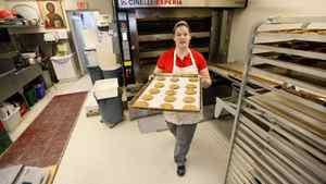 Sweets and pastry chef Stephanie Smith with freshly baked cookies at St. John's Bakery. The bakery gives people who might not otherwise have a chance get steady employment. 'This job means a lot to me,' Ms. Smith says.