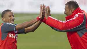 Toronto FC 's Joao Plata, left, celebrates after scoring from the penalty spot with head coach Aron Winter during second half MLS action against Houston Dynamo in Toronto on Saturday May 7, 2011. THE CANADIAN PRESS/Chris Young