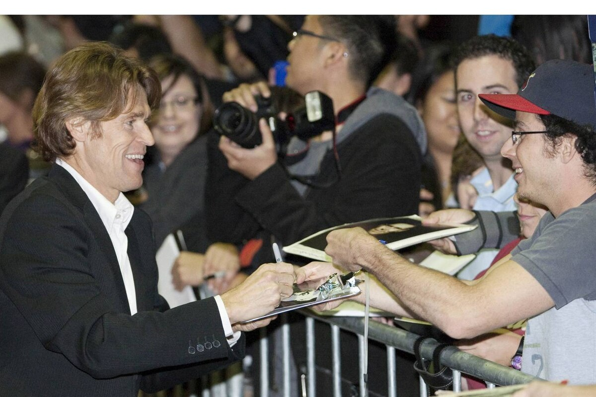 """Actor Willem Dafoe signs autographs as he arrives at the """"Antichrist"""" film gala at the Toronto International Film Festival on Sept. 11, 2009."""