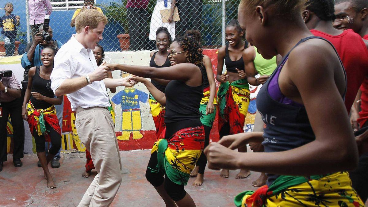 Prince Harry dances with Chantol Dormer at a youth community centre in Kingston, Jamaica on March 6, 2012. Suzanne Plunkett/Reuters