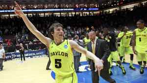 Baylor University's Brady Heslip celebrates after beating Colorado University 80-63 in their men's NCAA basketball game in Albuquerque, New Mexico, March 17, 2012.