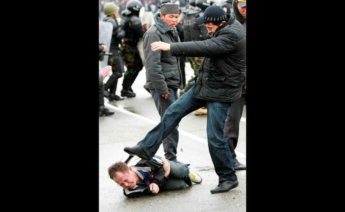 Editor's note: graphic images. A plain clothes policeman kicks an anti-government protester in Bishkek April 7, 2010.