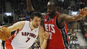 Toronto Raptors' Andrea Bargnani goes to the basket against New Jersey Nets' Johan Petro (R) during the first half of their NBA basketball game in Toronto, January 6, 2012. REUTERS/Mark Blinch