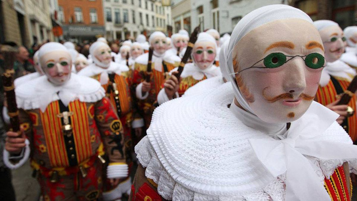 'Gilles of Binche' dance during a carnival parade in the city centre of Binche, Belgium, Tuesday, Feb. 21, 2012. The Carnival of Binche dates back to around the 14th century, with the clown-like Gilles performing their traditional dances to ward off evil spirits.