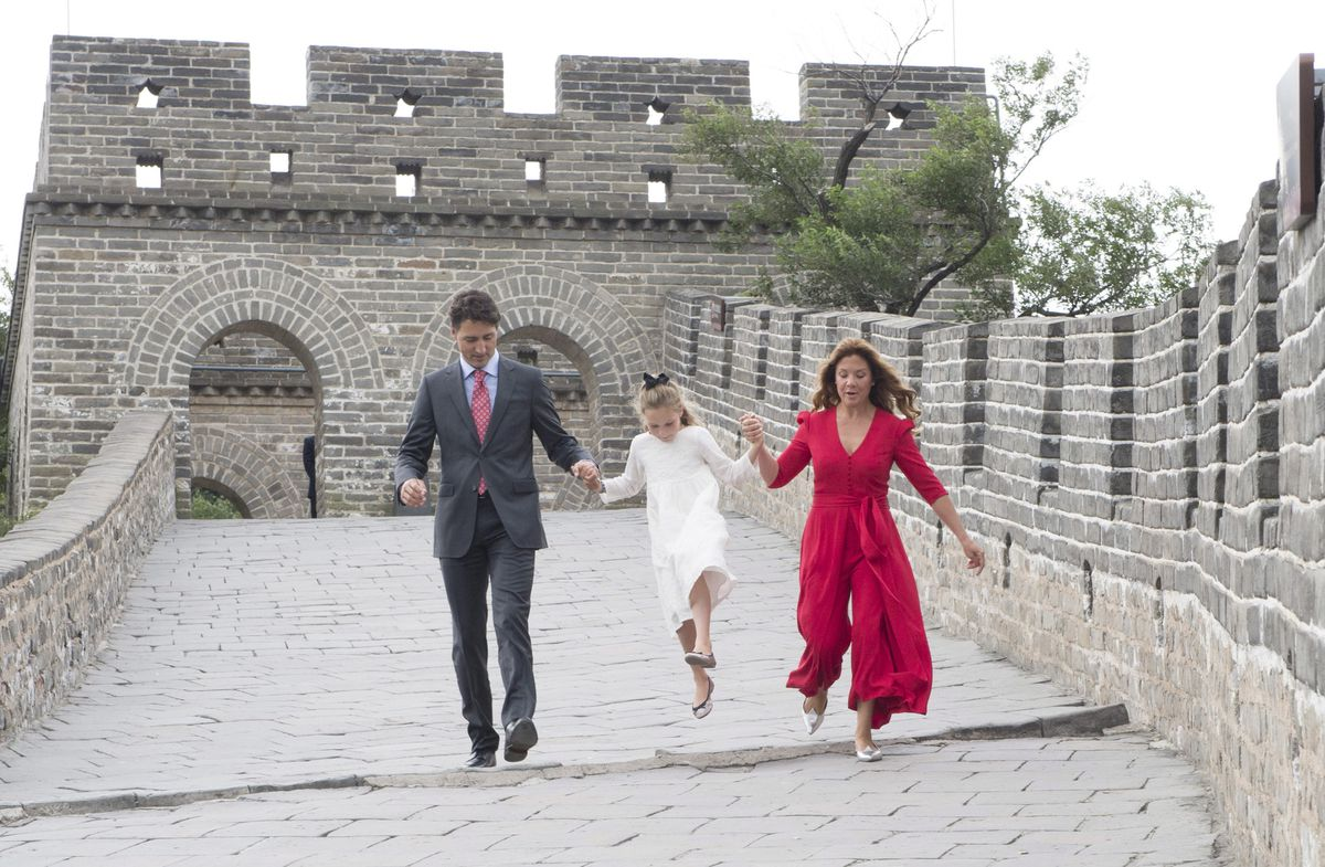 Justin Trudeau and Sophie Gregoire Trudeau help daughter Ella-Grace skip over a drainage pipe on the Great Wall of China in 2016.