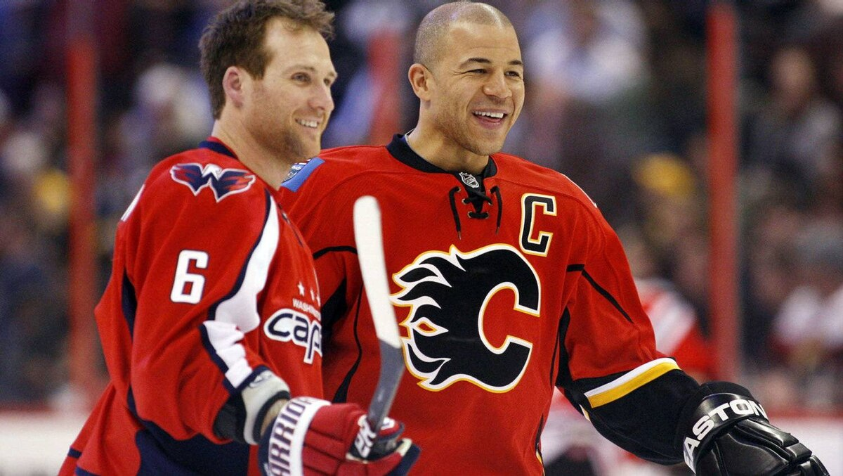 Calgary Flames Jarome Iginla (R) laughs with Washington Capitals Dennis Wideman during the NHL All-Star hockey skills competition in Ottawa January 28, 2012. REUTERS/Blair Gable