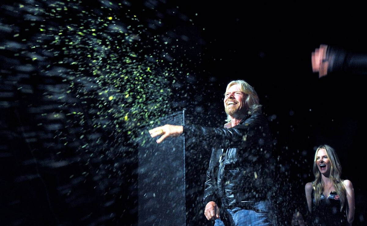 Sir Richard Branson playfully throws out maggots to the crowd during Virgin Mobile Fearless Day. Contestants faced challenges such as sorting through maggots for word clues, being chained in glass box while covered in snakes and climbing a ropes course.