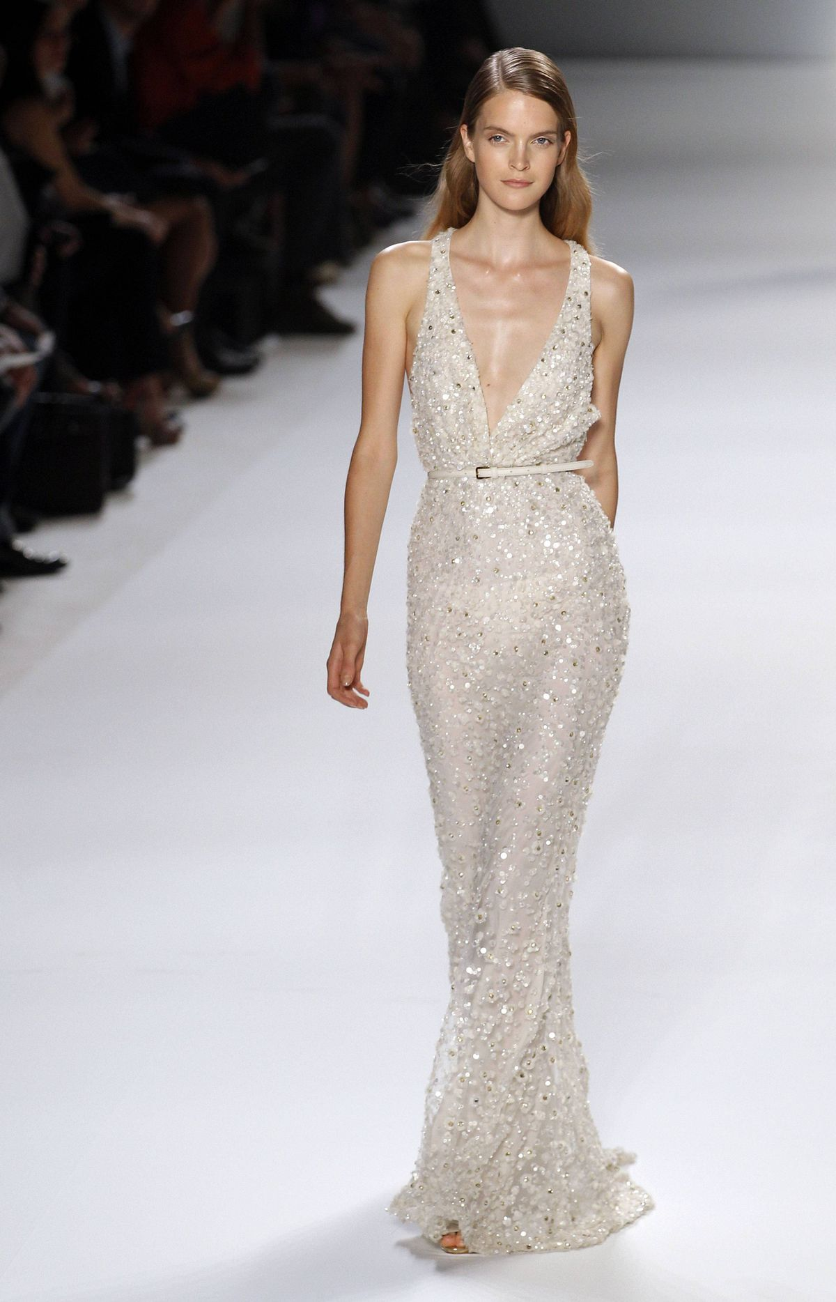 """Elie Saab Spring/Summer 2012 ready-to-wear collection Lebanese designer Elie Saab creates fashion for the red carpet. I suspect he's never met a spangle he doesn't like. As my show seatmate Flare editor Lisa Tant tweeted: """"Hollywood has him on speed dial."""" So this sequin dress, albeit pretty, came across as more of the same."""