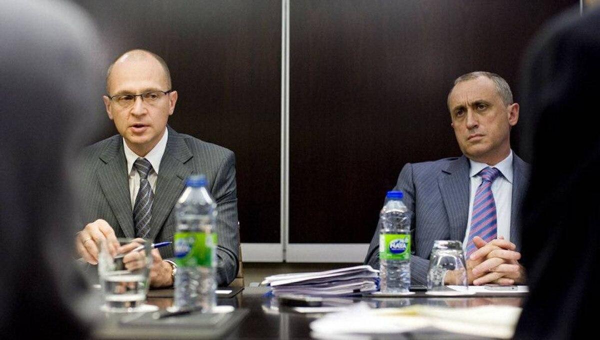 Sergey Kirienko, left, director general of Russia's Rosatom, and Vadim Zhivov, director general of ARMZ Uranium Holding Co., talk with reporters in Toronto on Tuesday