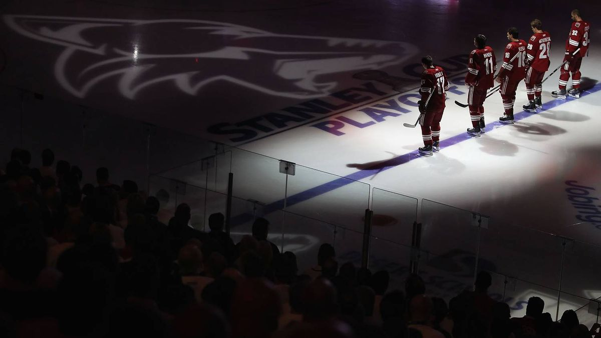 Members of the Phoenix Coyotes stand before Game 4 of the Western Conference Quarter-finals against the Detroit Red Wings during the 2011 NHL Stanley Cup Playoffs at Jobing.com Arena.