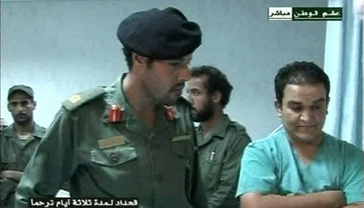 Still image from video footage by Libyan state television shows what it says is Muammar Gadhafi's son Khamis (2nd L) visiting wounded Libyans in a hospital August 9, 2011. Khamis Gadhafi was commander of Libya's 32nd Brigade, and a key member involved in leading the crackdown on the Libyan uprising. He has been reported killed several times only to reappear alive. His whereabouts are unknown. He has received military training in Russia and headed Libya's special forces.