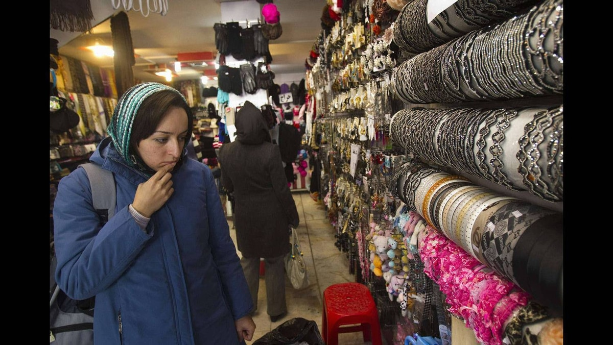 Customers shop at a store in Tehran January 6, 2012.