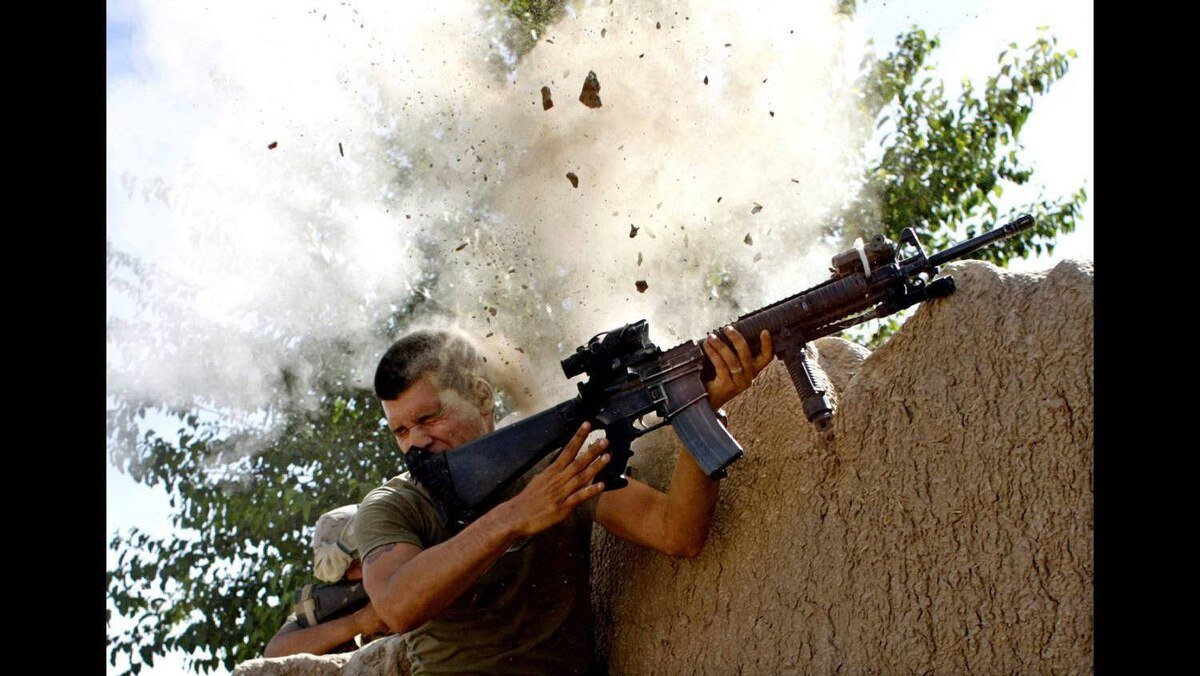 Sgt. William Olas Bee, a U.S. Marine from the 24th Marine Expeditionary Unit, has a close call after Taliban fighters opened fire near Garmsir in Helmand Province of Afghanistan, May 18, 2008.