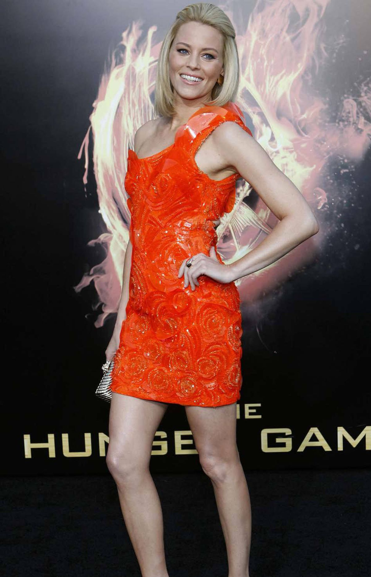 "And here she is at the premiere of ""The Hunger Games"" in Los Angeles on March 12. A few more premieres and she'll have a complete pack of Lifesavers!"