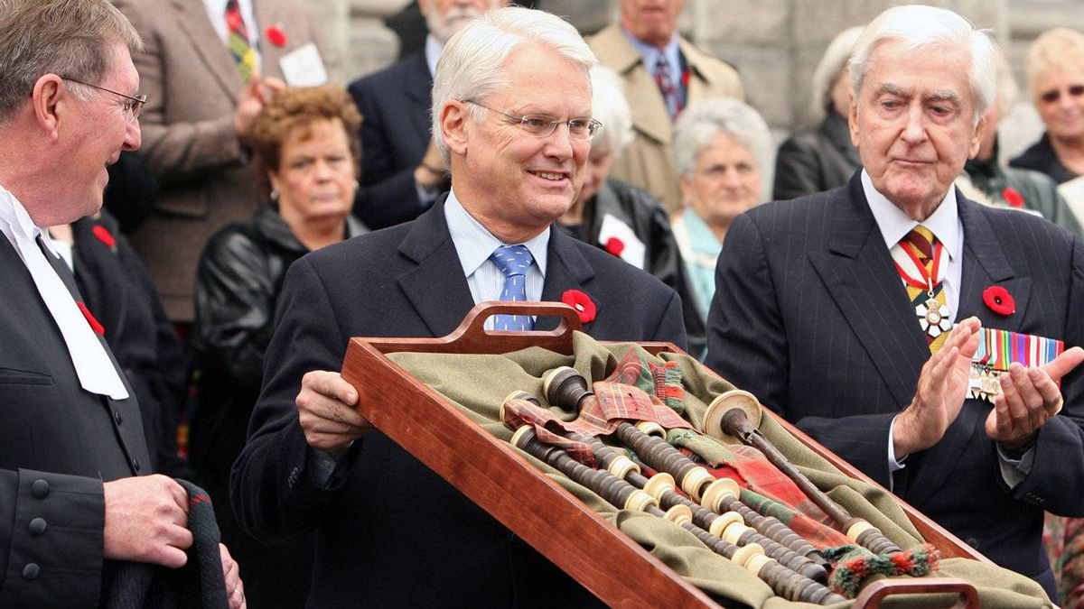 Former B.C premier Gordon Campbell holds up the pipes of Victoria Cross recipient James Richardson at a repatriation ceremony at the B.C. Legislature in Victoria in 2006, as Speaker Bill Barisoff, left and Patrick Reid of the Canadian Club look on. Mr. Richardson was Canada's only piper to be awarded a Victoria Cross.